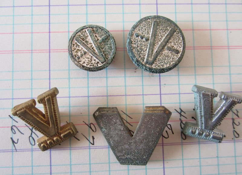 V buttons metal